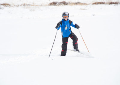 SCOUT SHOWING DIFFERENT MOVES IN SNOW SKIING FOR SNOW SKIING MERIT BADGE PAMPHLET
